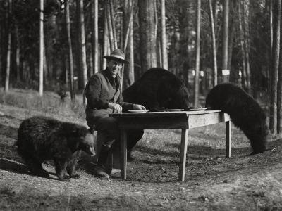 Superintendent Albright of Yellowstone Park Sits with Three Bears