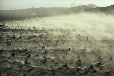 Hundreds of Motorcycles Racing Across the Dry California Ground
