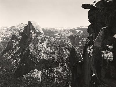 A Small Figure Contrasts Against Yosemite Valley and Half Dome
