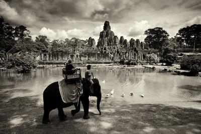 Tourists Travel by Elephant on the Grounds of the Temple, Bayon