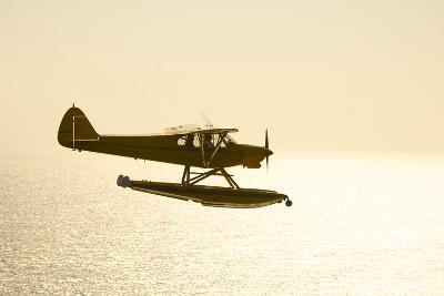 A PA18 Super Cub Floatplane Flying to Conception Island