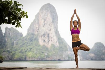A Woman Doing Tree Pose Or Vrksasana
