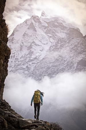 A Woman Climbing in the Khumbu Region of the Himalaya Mountains