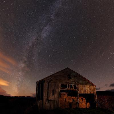The Milky Way Over An Old Barn Filled with Hay Bales
