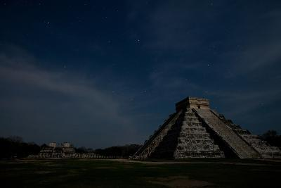The Step Pyramid, El Castillo, and Other Ruins at Chichen Itza Under a Star Filled Sky