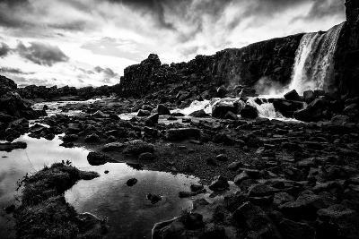 Heavy Clouds Over Oxararfoss Waterfall, and the Rocky Landscape Around It