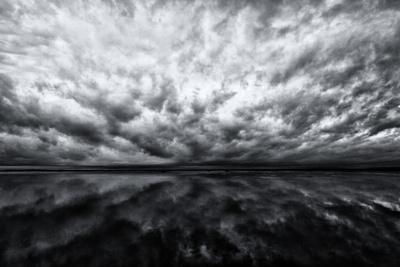 Heavy Dramatic Clouds and Their Reflection in Calm Water