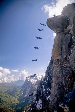 A Base Jumper Leaps Off the Mushroom, North Face of the Eiger, Bernese Oberland of the Swiss Alps
