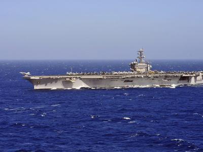 An F/A-18C Hornet Launches Off the Flight Deck of Aircraft Carrier USS Dwight D. Eisenhower