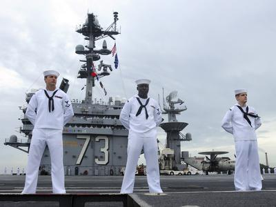 Sailors Man the Rails Aboard the Aircraft Carrier USS George Washington