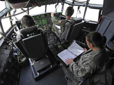Aircrew Perform Preflight Checklists in a C-130J Super Hercules Before Takeoff