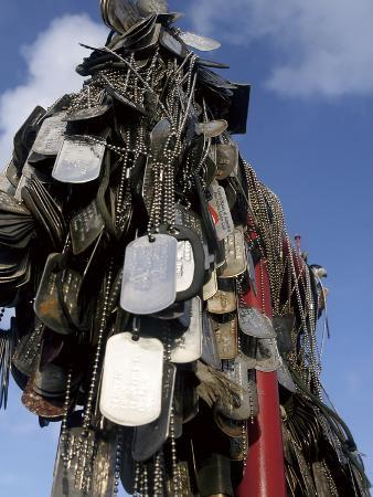 Dog Tags from Marines And Sailors Hang in Front of a Memorial in Iwo Jima.