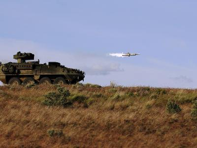 A TOW Missile Is Launched from An Armored Vehicle