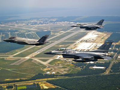F-35 Lightning II Aircraft in Flight with Two F-16 Fighting Falcons Over Florida