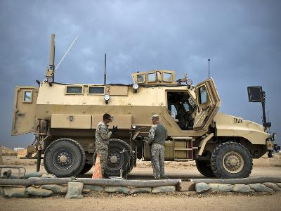 U.S. Army Sergeant Refuels a Caiman MRAP Vehicle, Iraq