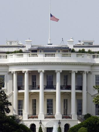The American Flag Flies at Half-staff Atop the White House