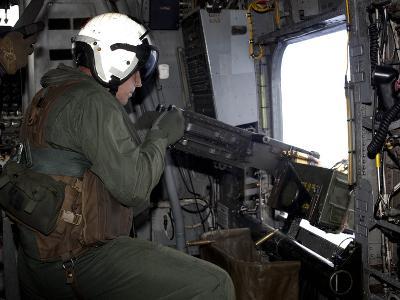 Crew Chief Fires An M2 .50-caliber Heavy Machine Gun from a CH-53E Super Stallion