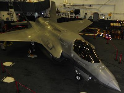 An F-35B Lightning II Is Secured in the Hangar Bay Aboard USS Wasp