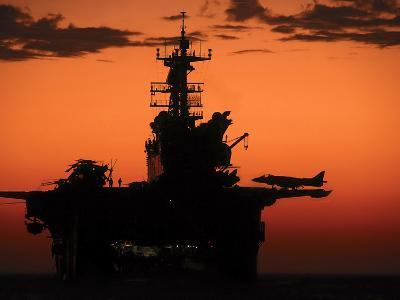 The Setting Sun Silhouettes the Amphibious Assault Ship USS Makin Island