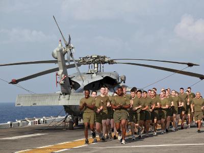Marines And Sailors Run Aboard USS Makin Island