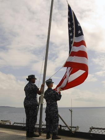 Sailors Raise the American Flag Aboard USS Tortuga