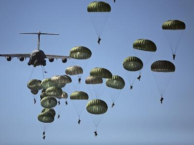U.S. Army Paratroopers Jumping Out of a C-17 Globemaster III Aircraft