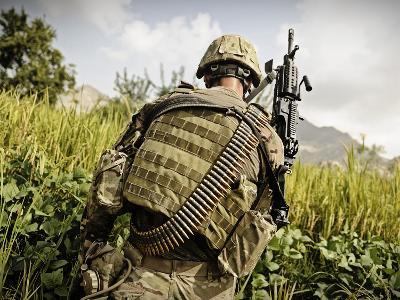 U.S. Army MK48 Machine Gunner Patrols Through a Field in Afghanistan