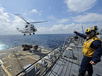 An AS-332 Super Puma Helicopter During a Vertical Replenishment