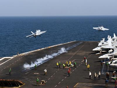 F/A-18F Super Hornets Launch Simultaneously from the Aircraft Carrier USS John C. Stennis