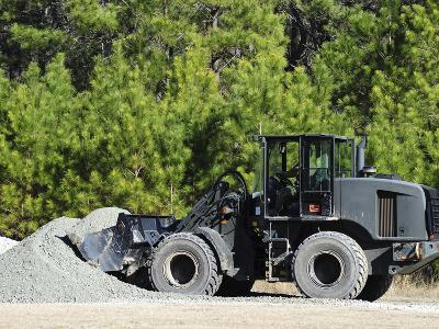 Equipment Operator Gathers a Load of Gravel On Camp Johnson