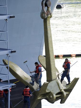 Sailors Paint the Starboard Anchor of the Aircraft Carrier USS Nimitz