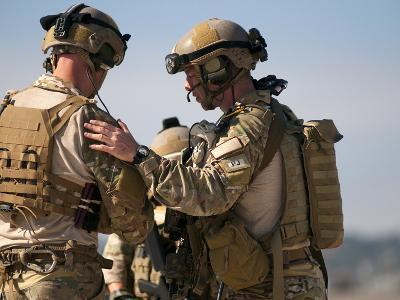 U.S. Air Force Pararescue Jumpers Review Their Notes And Plan of Action
