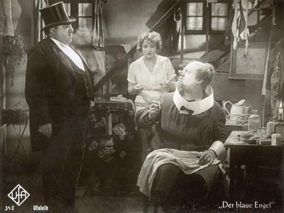 """Still from the Film """"The Blue Angel"""" with Marlene Dietrich, Kurt Gerron and Emil Jannings, 1930"""
