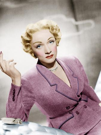 STAGE FRIGHT, Marlene Dietrich, wearing a suit by Christian Dior, 1950