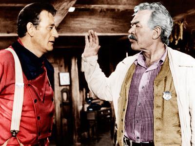 THE SEARCHERS, from left: John Wayne, Ward Bond, 1956