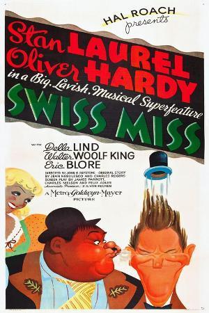 SWISS MISS, l-r: Oliver Hardy, Stan Laurel on poster art, 1938