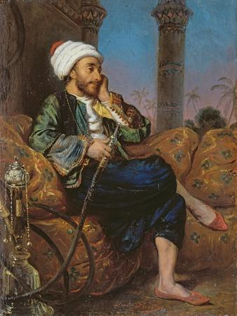 An Egyptian Man Smoking a Hookah