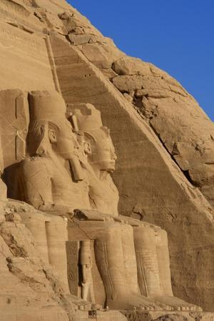 Egyptian Art. Great Temple of Ramses II. Two Colossal Statues Depicting the Pharaoh Ramses II…