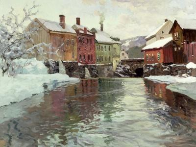 Snow-Covered Buildings by a River