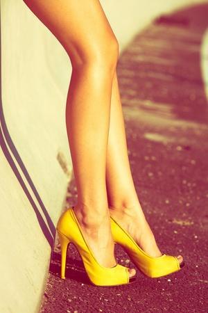 Woman Tan Legs In High Heel Yellow Shoes Outdoor Shot Summer Day