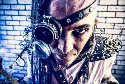 Portrait Of A Steampunk Man With A Mechanical Devices Over Brick Wall
