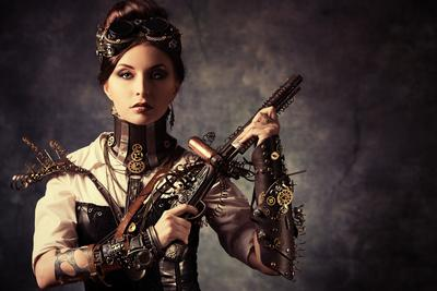 Portrait Of A Beautiful Steampunk Woman Holding A Gun Over Grunge Background