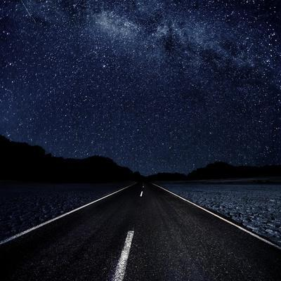 Highway And Starry Night In Desert