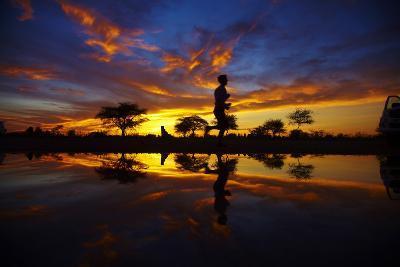 Runner at Sunrise, Okaukuejo Rest Camp, Etosha National Park, Namibia