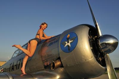 1940's Pin-Up Girl Standing on the Wing of a World War II T-6 Texan