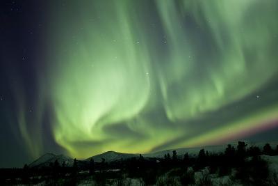 Aurora Borealis over Mountain, Yukon, Canada