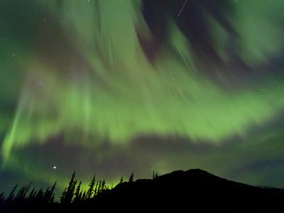 Aurora Borealis over Mountain, Marsh Lake, Yukon, Canada
