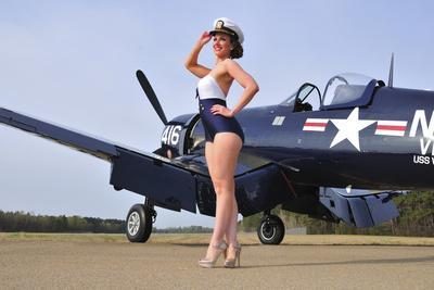 1940's Style Navy Pin-Up Girl Posing with a Vintage Corsair Aircraft