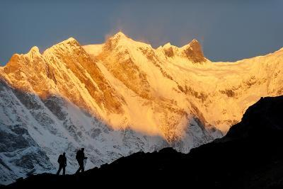 Two Trekkers Walk in Front of Annapurna