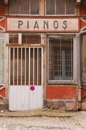 An Old Piano Store in the City of Dijon, Burgundy, France, Europe